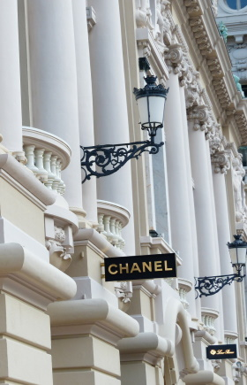 Photo of the outside of Chanel store in a luxurious shopping alley displaying high-end shopping locations