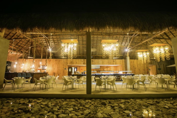 Outdoor bar and restaurant at night at all-inclusive girlfriend getaway resort Fiesta Americana Cozumel