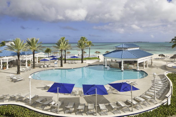 Photo showing the pool and swim up bar at Melia Nassau Beach all inclusive Bahamas resort overlooking the ocean