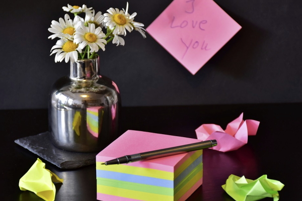 Image of sticky notes used to set up a Valentines Day scavenger hunt