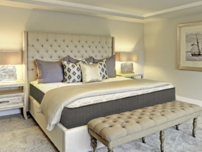 Image of the Sweet Zzz Natures Novel Mattress Placed in a Luxurious Bedroom with Gray and White Pillows