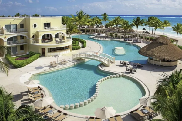 Image of the pool and beach at Dreams Tulum Resort & Spa