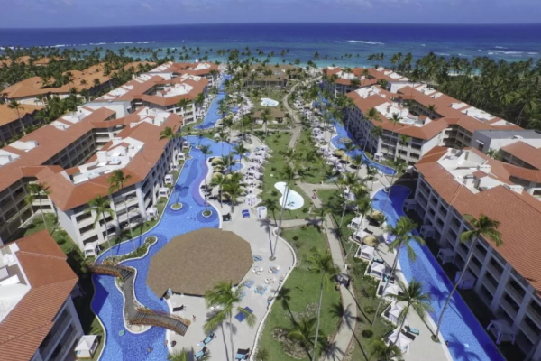 Image of the pool area at Majestic Mirage Punta Cana as one of the best getaways with the girls