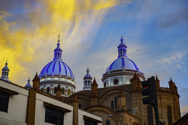 Image of gorgeous architecture and a sunset-filled sky in Ecuador